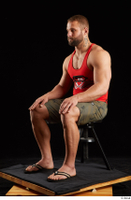 Dave  1 camo shorts dressed red tank top sandals sitting whole body 0008.jpg