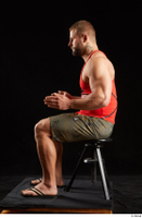 Dave  1 camo shorts dressed red tank top sandals sitting whole body 0009.jpg