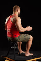 Dave  1 camo shorts dressed red tank top sandals sitting whole body 0012.jpg