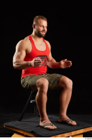 Dave  1 camo shorts dressed red tank top sandals sitting whole body 0014.jpg