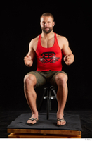 Dave  1 camo shorts dressed red tank top sandals sitting whole body 0015.jpg