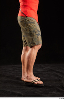 Dave  1 camo shorts dressed flexing leg sandals side view 0002.jpg