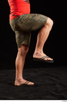 Dave  1 camo shorts dressed flexing leg sandals side view 0004.jpg