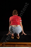 Ruby  1 dressed flip flop jeans shorts kneeling red t shirt whole body 0005.jpg