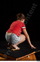 Ruby  1 dressed flip flop jeans shorts kneeling red t shirt whole body 0006.jpg