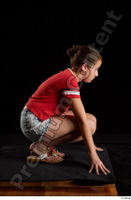 Ruby  1 dressed flip flop jeans shorts kneeling red t shirt whole body 0007.jpg