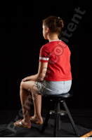 Ruby  1 dressed flip flop jeans shorts red t shirt sitting whole body 0002.jpg