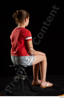 Ruby  1 dressed flip flop jeans shorts red t shirt sitting whole body 0004.jpg
