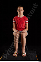 Ruby  1 dressed flip flop jeans shorts red t shirt sitting whole body 0007.jpg
