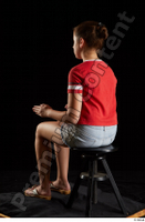 Ruby  1 dressed flip flop jeans shorts red t shirt sitting whole body 0010.jpg