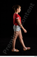 Ruby  1 dressed flip flop jeans shorts red t shirt side view walking whole body 0004.jpg