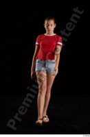 Ruby  1 dressed flip flop front view jeans shorts red t shirt walking whole body 0001.jpg