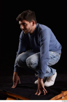 Hamza  1 blue jeans blue sweatshirt dressed kneeling white sneakers whole body 0002.jpg