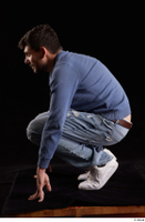 Hamza  1 blue jeans blue sweatshirt dressed kneeling white sneakers whole body 0003.jpg