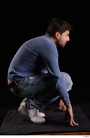 Hamza  1 blue jeans blue sweatshirt dressed kneeling white sneakers whole body 0007.jpg