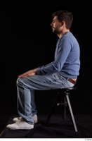 Hamza  1 blue jeans blue sweatshirt dressed sitting white sneakers whole body 0001.jpg