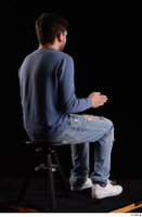 Hamza  1 blue jeans blue sweatshirt dressed sitting white sneakers whole body 0012.jpg