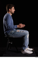Hamza  1 blue jeans blue sweatshirt dressed sitting white sneakers whole body 0013.jpg
