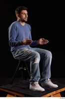 Hamza  1 blue jeans blue sweatshirt dressed sitting white sneakers whole body 0014.jpg