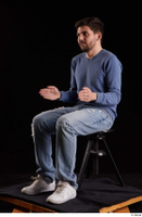 Hamza  1 blue jeans blue sweatshirt dressed sitting white sneakers whole body 0016.jpg