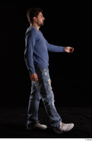 Hamza  1 blue jeans blue sweatshirt dressed side view walking white sneakers whole body 0001.jpg