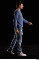 Hamza  1 blue jeans blue sweatshirt dressed side view walking white sneakers whole body 0002.jpg