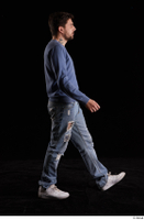 Hamza  1 blue jeans blue sweatshirt dressed side view walking white sneakers whole body 0004.jpg