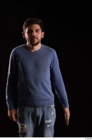Hamza  1 arm blue sweatshirt dressed flexing front view 0001.jpg