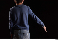 Hamza  1 arm back view blue sweatshirt dressed flexing 0002.jpg