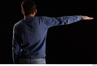 Hamza  1 arm back view blue sweatshirt dressed flexing 0003.jpg