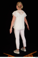 Donna dressed sneakers standing white pants white top whole body 0004.jpg