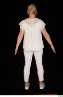 Donna dressed sneakers standing white pants white top whole body 0005.jpg