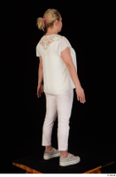 Donna dressed sneakers standing white pants white top whole body 0006.jpg