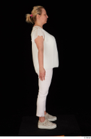 Donna dressed sneakers standing white pants white top whole body 0007.jpg