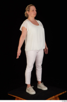 Donna dressed sneakers standing white pants white top whole body 0008.jpg
