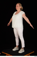 Donna dressed sneakers standing white pants white top whole body 0010.jpg