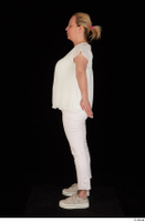 Donna dressed sneakers standing white pants white top whole body 0011.jpg