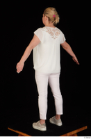 Donna dressed sneakers standing white pants white top whole body 0012.jpg
