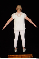 Donna dressed sneakers standing white pants white top whole body 0013.jpg