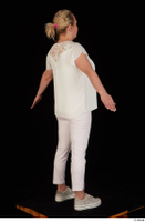 Donna dressed sneakers standing white pants white top whole body 0014.jpg