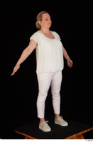 Donna dressed sneakers standing white pants white top whole body 0016.jpg