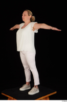 Donna dressed sneakers standing t poses white pants white top whole body 0002.jpg