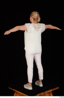 Donna dressed sneakers standing t poses white pants white top whole body 0004.jpg