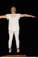 Donna dressed sneakers standing t poses white pants white top whole body 0005.jpg