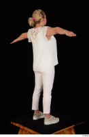 Donna dressed sneakers standing t poses white pants white top whole body 0006.jpg
