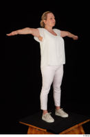 Donna dressed sneakers standing t poses white pants white top whole body 0008.jpg