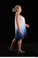 Donna  1 black sandals dressed side view walking white-blue dress whole body 0002.jpg