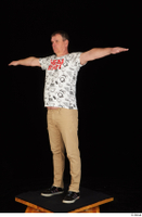 Spencer black sneakers brown trousers dressed standing t poses white printed t shirt whole body 0002.jpg