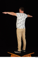 Spencer black sneakers brown trousers dressed standing t poses white printed t shirt whole body 0004.jpg