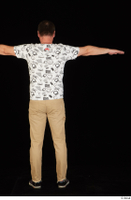Spencer black sneakers brown trousers dressed standing t poses white printed t shirt whole body 0005.jpg